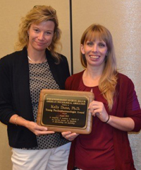 President Elect Stacey Sigmon with Young Psychopharmacologist Award winner Kelly Dunn