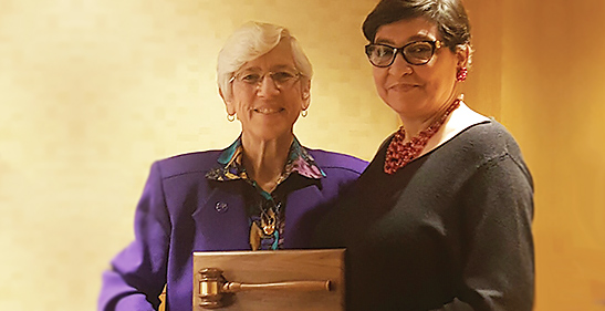 Dinelia Rosa, PhD, honored for her leadership in 2016. Presented by 2017 President Linda Knauss, PhD (left).