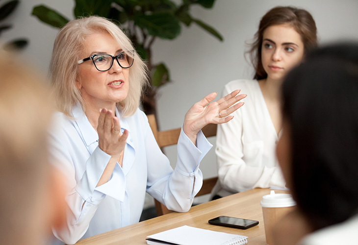 Woman in office meeting
